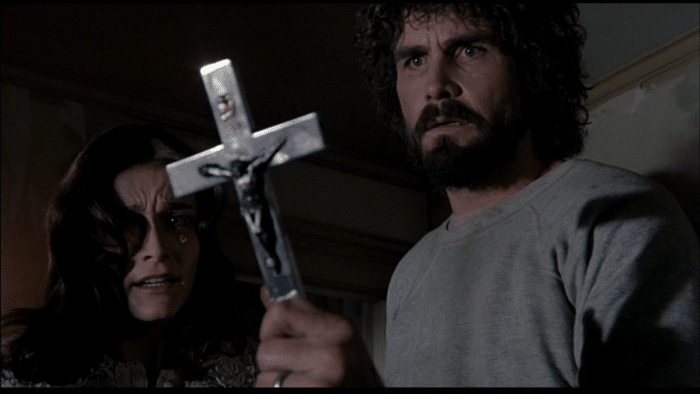 https://cinemodern.ir/wp-content/uploads/2017/10/The-Amityville-Horror-1979-Margot-Kidder-James-9Brolin-cross-w700.png